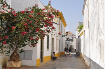 A cobbled street in Portugal - Algarve is a well-known tourist area in southern Portugal. Every year, tens of thousands of tourists
