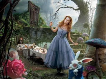 Alice in Wonderland - a richly set table in the forest