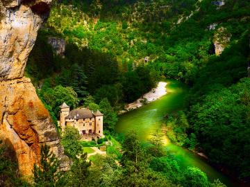 castle on the river - River in the mountains and castle