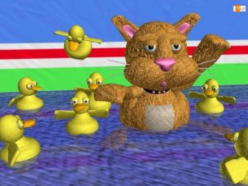 extremely - teddy bear and ducklings are swimming in the pool