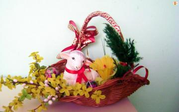 Easter atmosphere - lamb in basket and forsythia