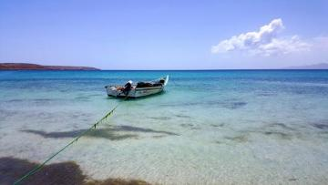 A boat anchored on the sea. - A boat anchored on the sea.