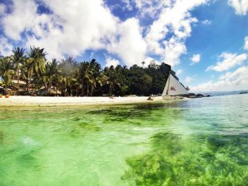 Boracay. Philippines. - A tiny, charming island. Once you reach Manila, the travel costs are really low.