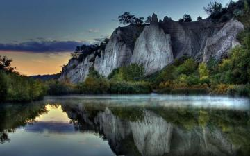 The beauty of nature - Evening reflection in the water of the trees