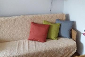 couch with pillows - sofa with pillows in a large room