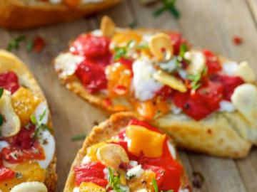 Delicious toasts - Delicious toasts with tomatoes and other toppings.