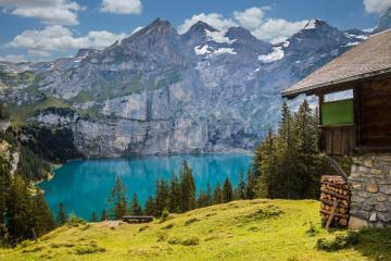 Mountain shelter - Mountain hut with lake and mountain backdrop