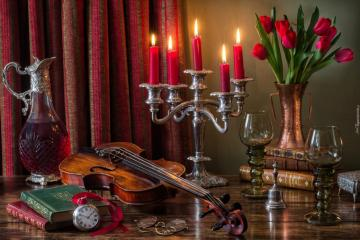 violin next to the candlestick with red candles - violin next to the candlestick with red candles