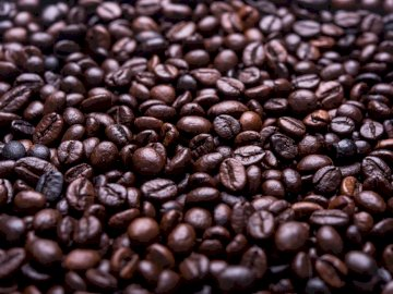 Fresh coffee beans - Photograph of roasted coffee beans. Romania