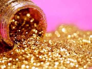 A close up macro shot of a - Gold glitter with jar. New Hampshire, USA