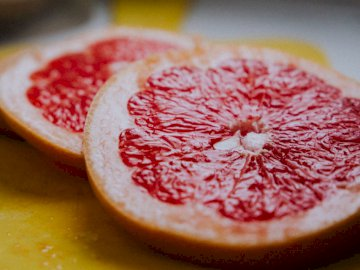Grapefruit - Red and white round fruit.