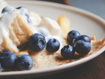 Blueberry Dessert - Bowl of blue berries with cream. Cracow, Poland