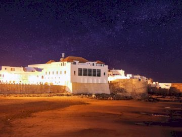 Assila city - White concrete structure during nighttime. Asilah